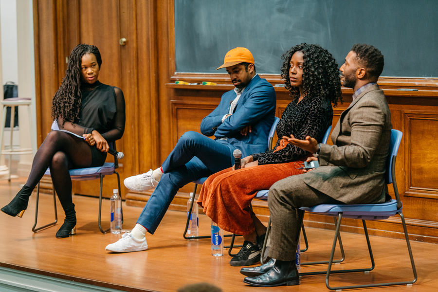 Britt Julious (left) moderates a panel of journalists Rembert Browne, Doreen St. Félix and Wesley Morris in Harris Hall on Thursday. The panel discussed their personal experiences in newsrooms during a changing media landscape.