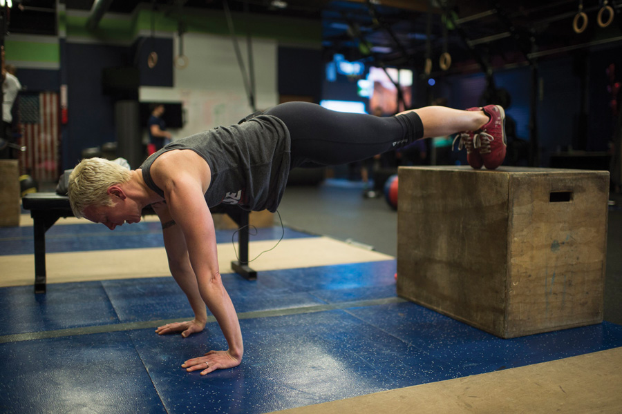 A CrossFit trainer demonstrates decline pushups. Owner Tani Mintz said her new studio, Sharp Edge CrossFit, will have its grand opening on Sunday.