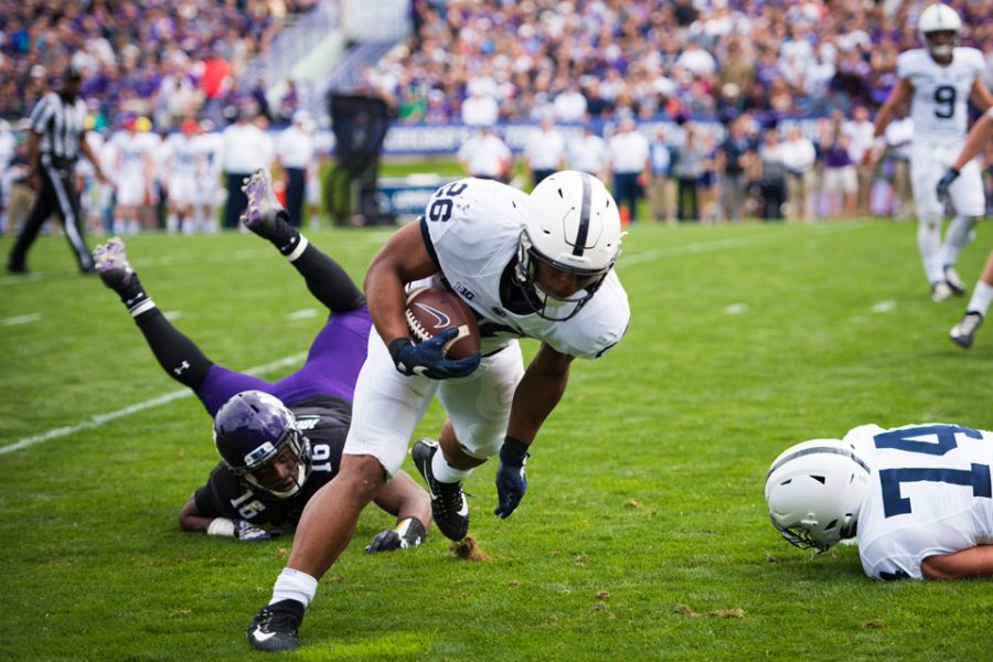 Godwin+Igwebuike+misses+a+tackle+on+Penn+State+running+back+Saquon+Barkley.+Igwebuike%2C+a+senior+safety%2C+was+ejected+for+a+targeting+penalty+in+the+second+half+of+Northwestern%27s+loss+to+No.+4+Penn+State.