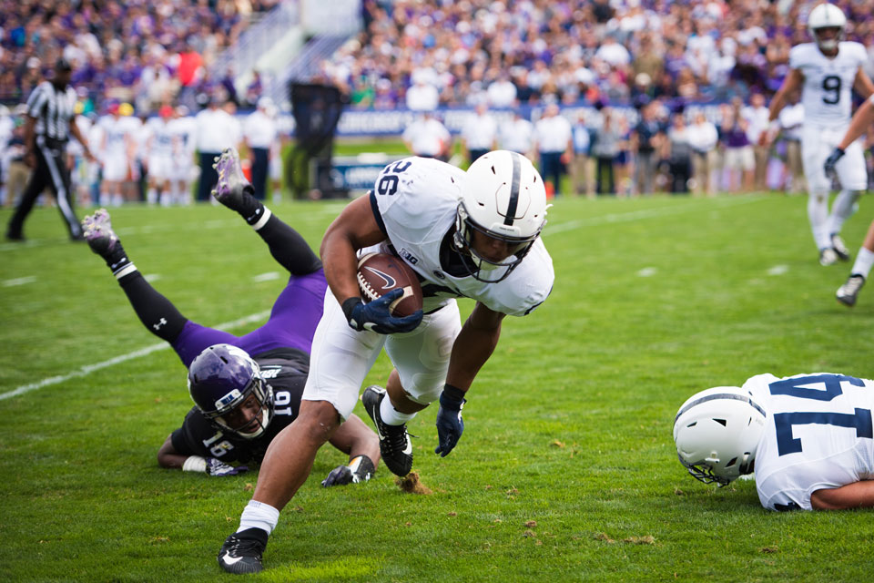 Godwin Igwebuike misses a tackle on Penn State running back Saquon Barkley. Igwebuike, a senior safety, was ejected for a targeting penalty in the second half of Northwestern's loss to No. 4 Penn State.