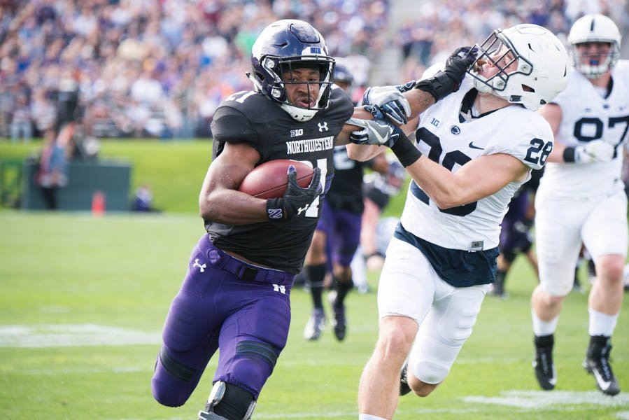 Justin Jackson stiff-arms a Penn State defender in 2017. The former Northwestern running back has been a critical part of the Los Angeles Chargers' offense in 2020.
