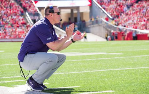 Pat Fitzgerald coaches from the sideline. Fitzgerald this week defended a controversial option play-call on fourth-and-three against Penn State.