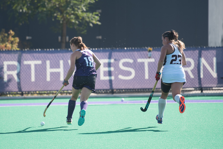 Lily Katzman holds off a Rutgers defender. The sophomore midfielder and the Cats look to remain undefeated at home this weekend.