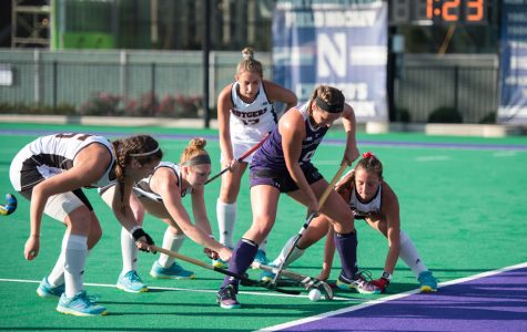 Pascale Massey gets surrounded by four defenders. The junior forward scored a goal in Northwestern's win over Rutgers on Friday.