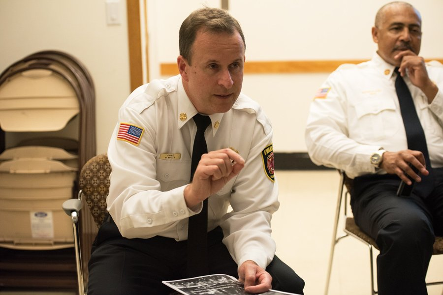 Fire chief Brian Scott speaks at a Tuesday community outreach meeting. The Evanston Fire Department is considering implementing a mobile healthcare program and using drones in future operations.