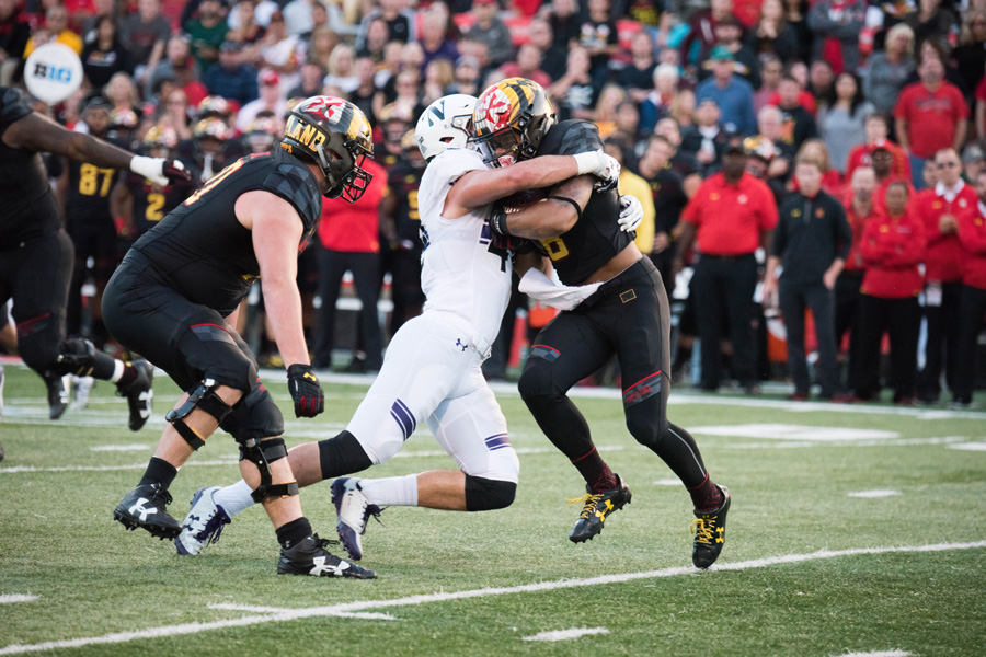 Paddy Fisher tackles a Maryland player in Northwestern's game against the Terrapins earlier this month. The redshirt freshman linebacker has stepped up this season.