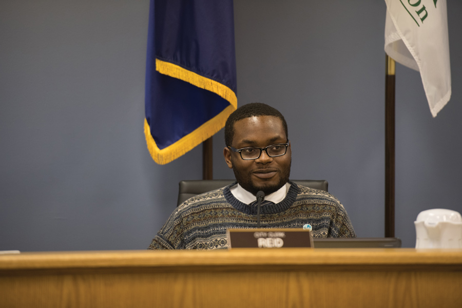 City clerk Devon Reid at Monday's City Council meeting. Aldermen voted unanimously to appoint Reid as Evanston's Freedom of Information Act officer, but decided to further discuss how and when information should be publicized.
