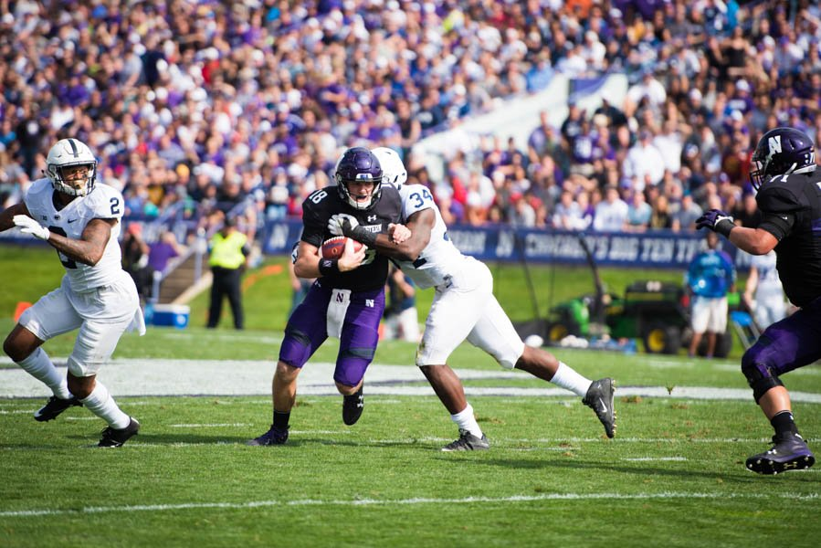 Clayton+Thorson+gets+tackled.+The+junior+quarterback+passed+for+142+yards+in+Northwestern%27s+homecoming+loss.+