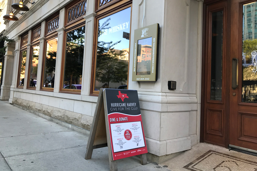 """A sign advertising """"Give for the Gulf"""" outside Whiskey Thief, 616 Davis St. The month-long effort to support victims of recent hurricanes raised more than $12,000."""