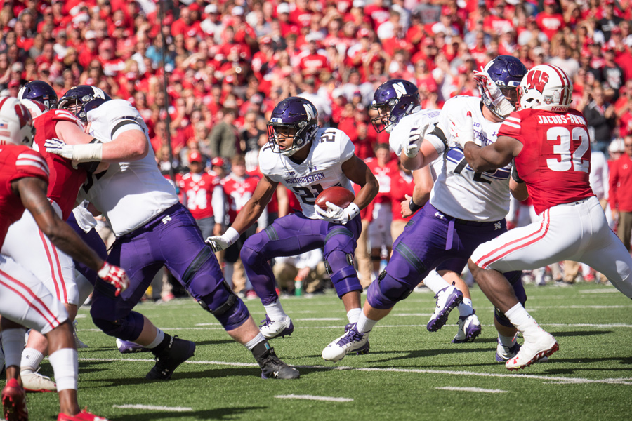Justin Jackson carries the ball. The senior enters the weekend on the cusp of Northwestern's career rushing record.