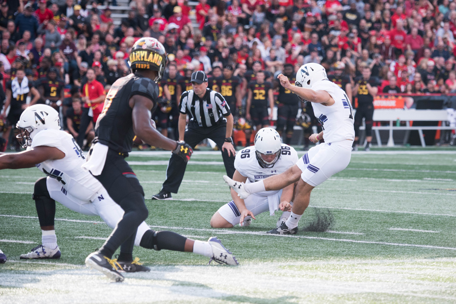 Charlie Kuhbander kicks. The freshman kicker knocked in three field goals and four extra points in Maryland last week.
