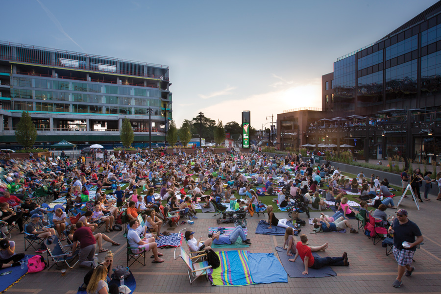 Chicagoans sit on the Park at Wrigley lawn. Park at Wrigley will double as a venue for The Line-Up, a live classical music concert showcasing local musicians.