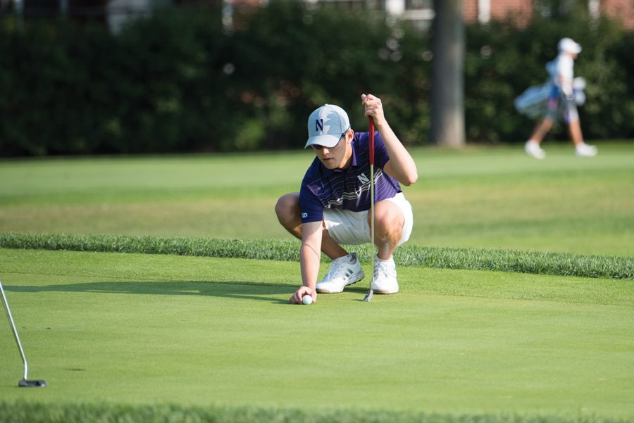 Everton Hawkins surveys the green. The sophomore led Northwestern to a tie for the win at the Windon Memorial Classic.