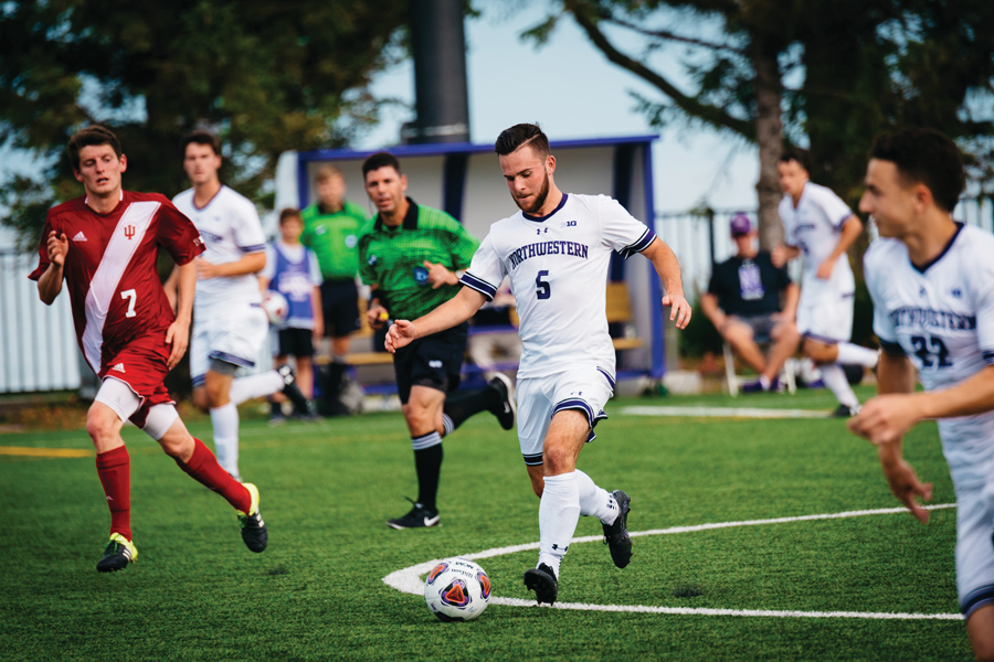 Camden Buescher kicks the ball. The junior midfielder and the Wildcats got wins against both Western Illinois and DePaul.