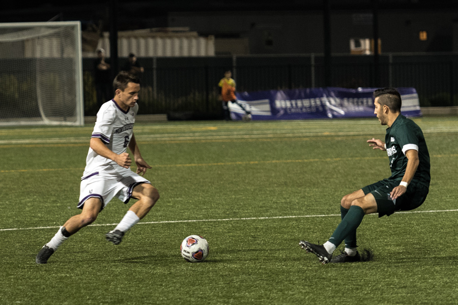 Riley Kelliher jukes a defender to the ground. The senior defender will look to lead the Wildcats over Penn State in their final regular season game.
