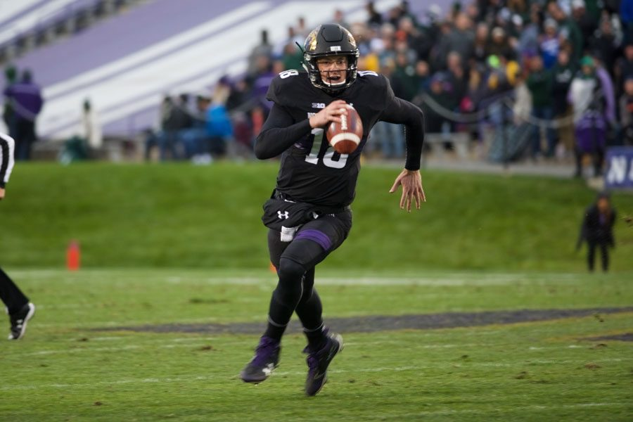 Clayton Thorson runs with the ball. The junior quarterback tossed for 356 yards against Michigan State.