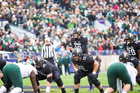 Clayton Thorson snaps the ball. The junior quarterback passed for 356 yards against the No. 16 Spartans.