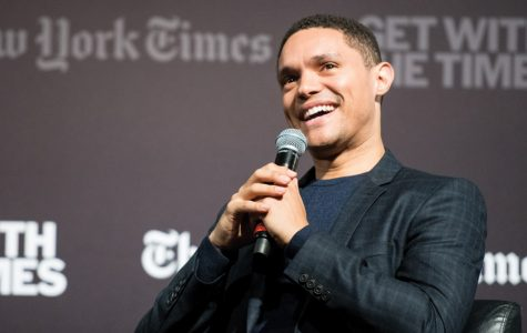 """""""The Daily Show"""" host Trevor Noah speaks on Sunday in Cahn Auditorium. Noah discussed his experiences as a black man living in South Africa and the United States in a conversation with John Eligon (Medill '04)."""