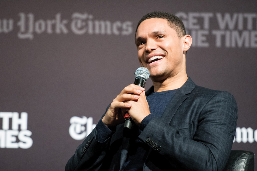 """The Daily Show"" host Trevor Noah speaks on Sunday in Cahn Auditorium. Noah discussed his experiences as a black man living in South Africa and the United States in a conversation with John Eligon (Medill '04)."