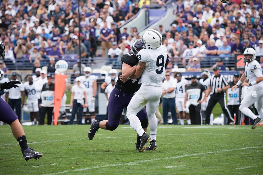 Paddy+Fisher+delivers+a+hit+on+Penn+State+quarterback+Trace+McSorley+that+led+to+an+ejection+for+targeting.+The+redshirt+freshman+linebacker+was+one+of+two+Northwestern+players+ejected+for+the+foul+against+the+Nittany+Lions.%0A