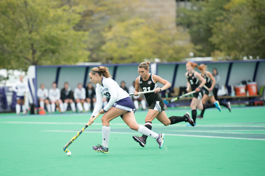 Puck Pentenga dribbles the ball. The junior midfielder was named Big Ten Offensive Player of the Week after scoring three goals and assisting on another last weekend.