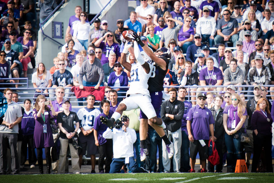Armani Oruwariye intercepts a pass intended for sophomore receiver Ben Skowronek. The Wildcats turned the ball over three times in their loss to Penn State