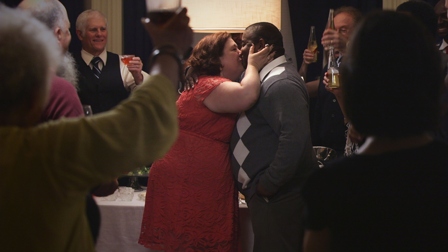 "Grace (Sara Sevigny) and Zeke (Antoine McKay) kiss at a party. The two played one of the interracial couples in ""Rogers Park."""