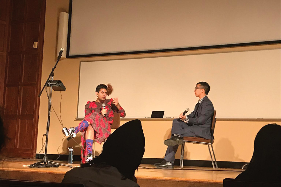 Gender-nonconforming artist Alok Vaid-Menon speaks to students about the challenges transgender people face. They also performed poetry at the event in Lutkin Hall on Friday, sponsored by the Asian Pacific American Coalition and South Asian Student Alliance.