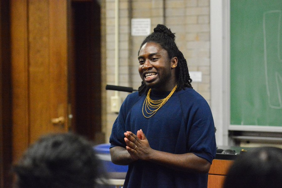 Kavi Ade performs at a Rainbow Week event on Thursday. The spoken word poet read some of their work and discussed their experiences with race, gender and politics.