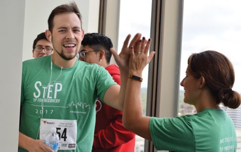 Community members climb 20 floors to raise funds for addiction treatment