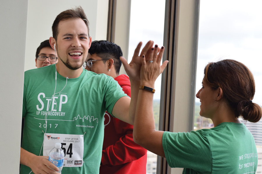 A Step Up for Recovery participant reaches the finish line on Bank One tower's 20th story. More than 200 community members engaged in the event, organized by PEER Services, to raise funds for substance abuse treatment.