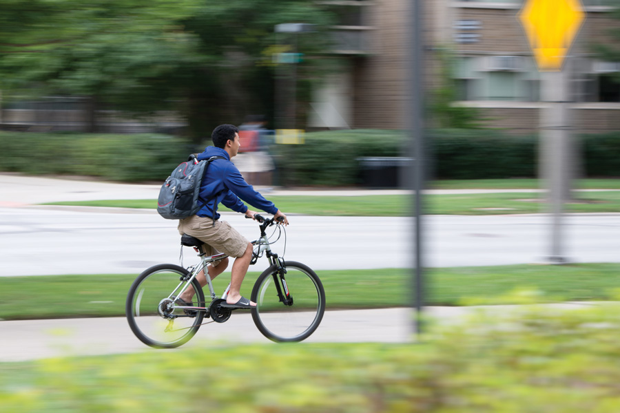 A NU student rides his bike along Sheridan Road. The new sustainability plan announced on Tuesday included transportation initiatives, such as an effort to increase bike commuting by 10 percent.