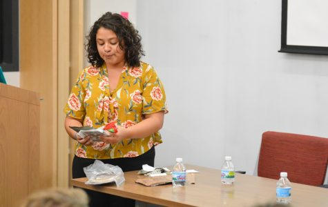 Second-year graduate student Zorimar Rivera Montes shows students samples of government-provided food from Puerto Rico. Rivera Montes co-led a teach-in Tuesday focusing on the history of Puerto Rico and the effects of Hurricane Maria.