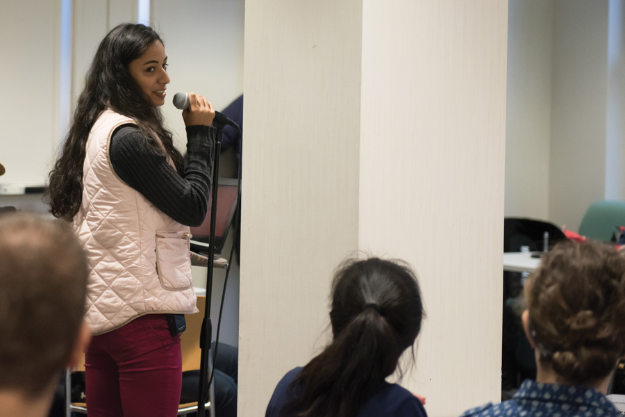 Communication sophomore Kimani Isaac speaks at a community dialogue on Monday. Isaac presented her petition calling on the University to lower the amount spent on textbooks.