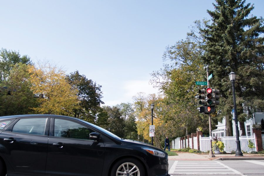 A car moves near the intersection of Ridge Avenue and Greenleaf Street. Evanston Police Department announced Tuesday a traffic initiative aimed at reducing crashes in the area.