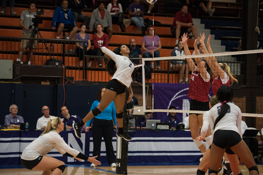 Symone Abbott spikes the ball. The senior outside hitter and the Wildcats lost twice over the weekend.