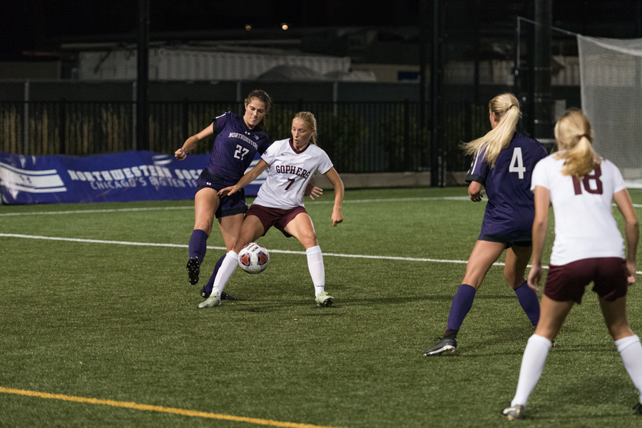 Kayla Sharples fights for the ball. The junior defender and the Wildcats will put their two-game win streak on the line against Nebraska on Saturday.