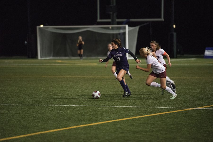 McKenna+Angotti+fights+a+defender+for+the+ball.+The+freshman+midfielder+and+the+Wildcats+will+face+Michigan+State+on+Wednesday.+