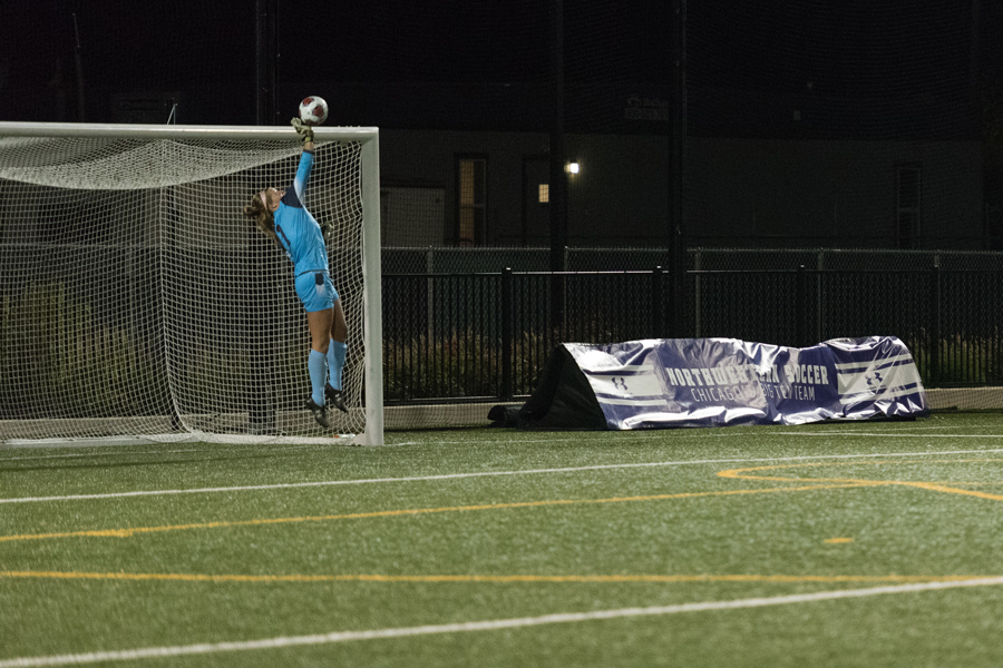 Lauren Clem jumps to make a save. The senior goalkeeper turned in a clean sheet in Northwestern's 2-0 win over Minnesota on Thursday.