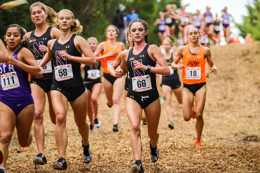 Amanda Davis (right) runs next to two teammates. The freshman and the Wildcats will head to Indiana this weekend for the Big Ten Championships.