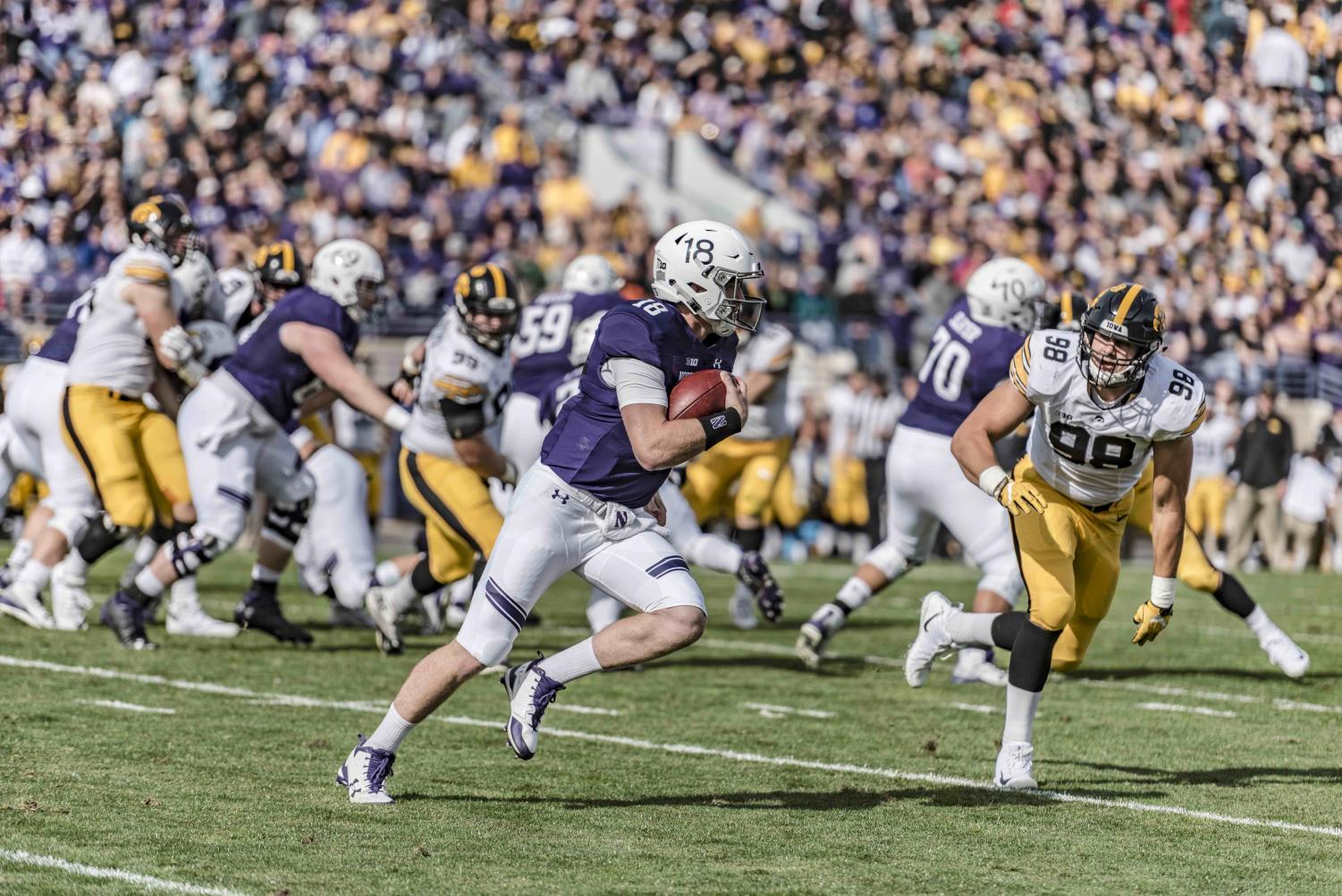Clayton Thorson runs with the football. The junior quarterback passed for 192 yards against the Hawkeyes.