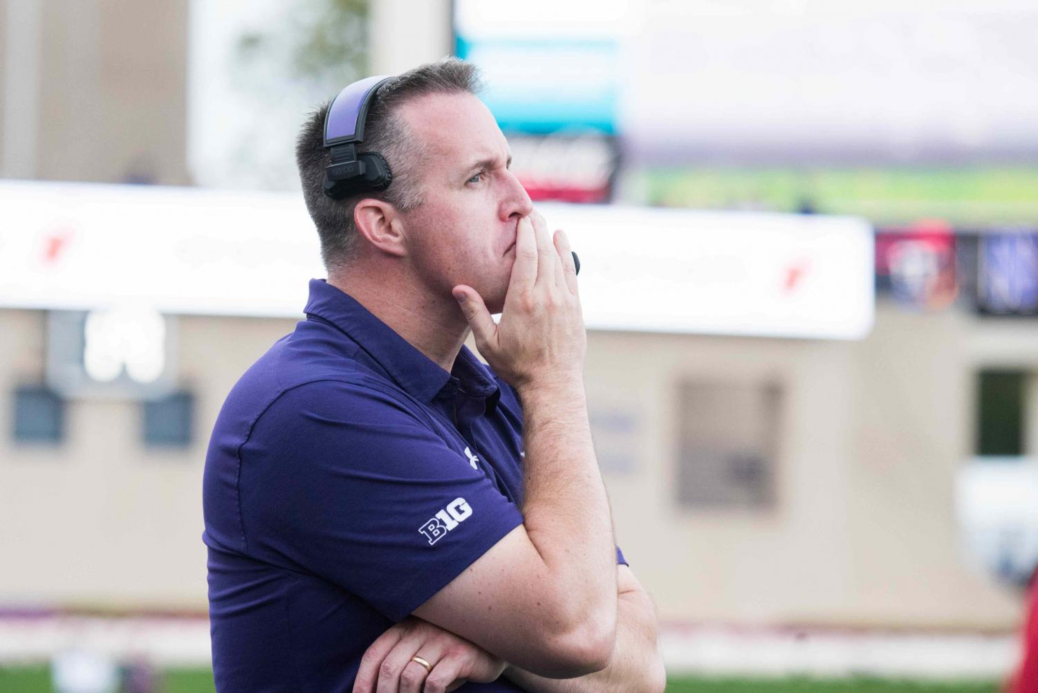Pat Fitzgerald looks on from the sideline. The coach said windy conditions at Ryan Field played into his decision-making Saturday.