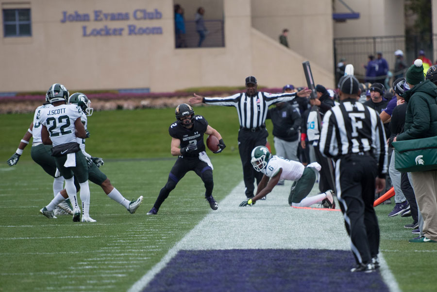 Flynn Nagel steps out of bounds. The junior receiver caught the final go-ahead touchdown in Northwestern's win over Michigan State on Saturday.