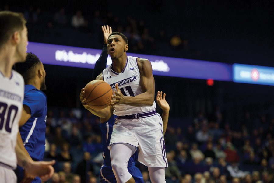 Anthony+Gaines+drives+to+the+basket.+The+freshman+guard+scored+1+of+Northwestern%E2%80%99s+4+bench+points+Wednesday.