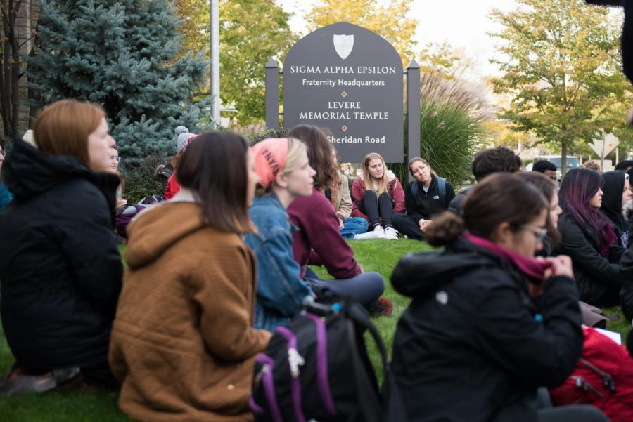 Students+sit+on+the+lawn+of+Sigma+Alpha+Epsilon%E2%80%99s+headquarters+as+part+of+a+protest+to+support+survivors+of+sexual+assault.+Several+students+shared+their+concerns+about+rape+culture+as+well+as+their+own+stories.+