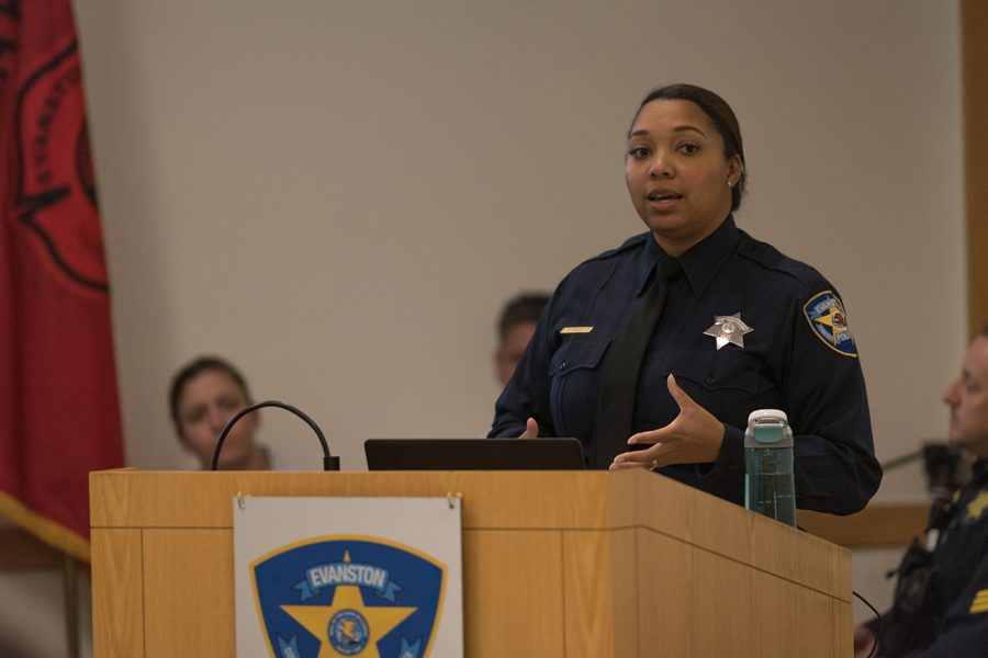 Officer Enjoli Daley talks during the information session for the new Police Explorer Program. After 30 years of inactivity in Evanston, the program will prepare youth for careers in law enforcement.