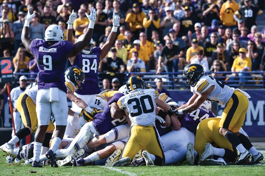Garrett+Dickerson+and+Cameron+Green+celebrate+a+touchdown.+The+Wildcats+made+their+first+appearance+of+the+season+in+the+college+football+playoff+rankings%2C+coming+in+at+No.+25.
