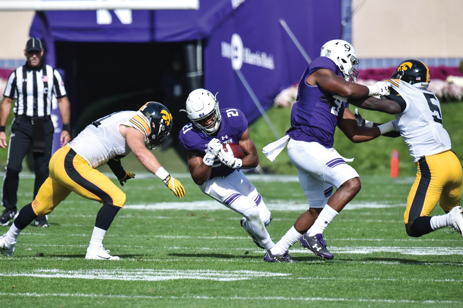Justin Jackson prepares for impact. The senior leads the team with 798 rushing yards on the season.