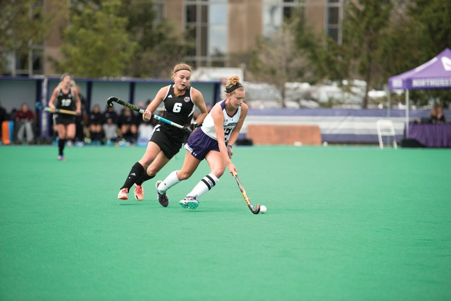 Elena+Curley+runs+upfield.+The+senior+midfielder+and+the+Wildcats+fell+to+top-seeded+Michigan+in+the+Big+Ten+tournament+semifinals+Friday.