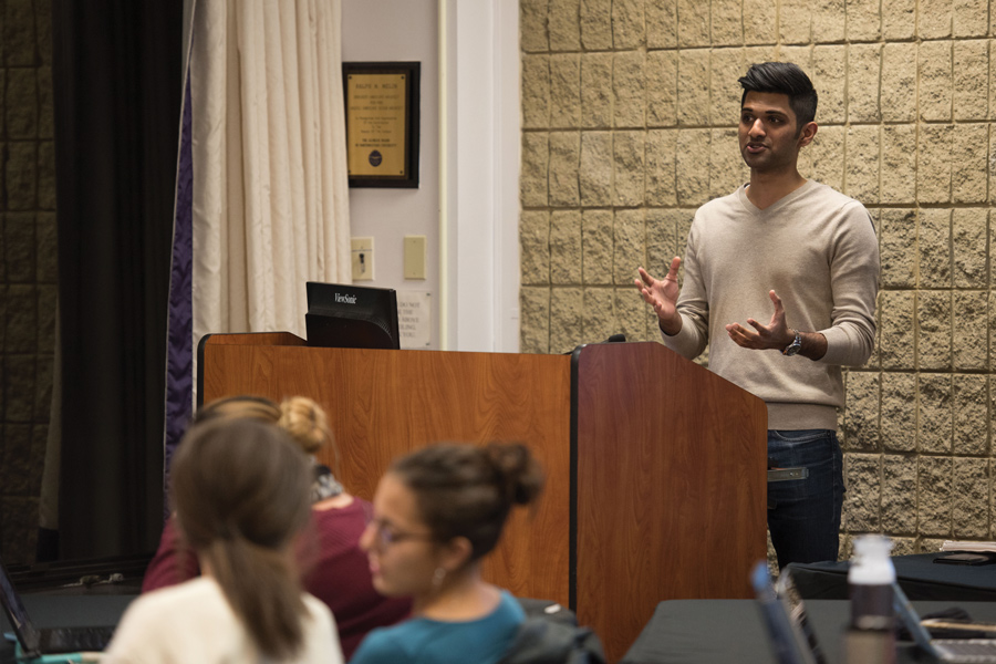 Parth Lalkiya, ASG vice president for B-status finances, speaks during Senate on Wednesday. ASG is expected to vote on a code change which would limit publicity funding for student groups who advertise using ground flyers.